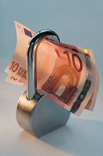 Close up lock and paper euros : Stock Photo