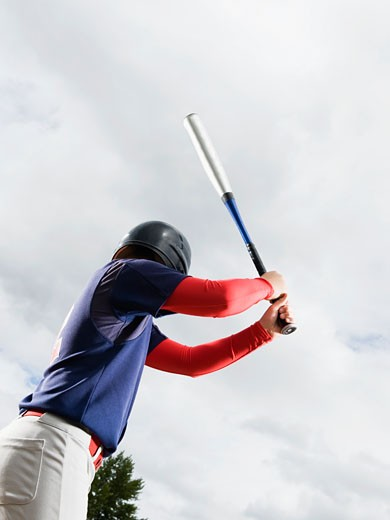 Baseball player reading to swing bat : Stock Photo