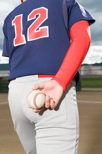 Stock Photo: 1795R-16437 Baseball pitcher getting ready to throw ball