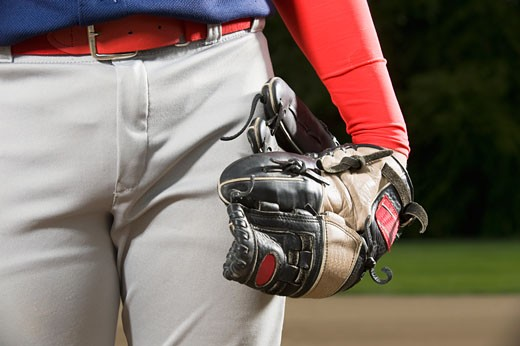 Stock Photo: 1795R-16450 Baseball player holding mitt at side