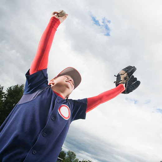 Stock Photo: 1795R-16463 Baseball player celebrating with arms raised