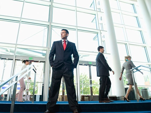 Confident businessman posing in lobby : Stock Photo