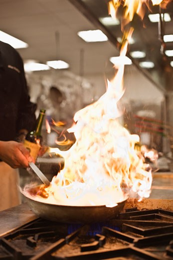 Chef cooking with flame : Stock Photo