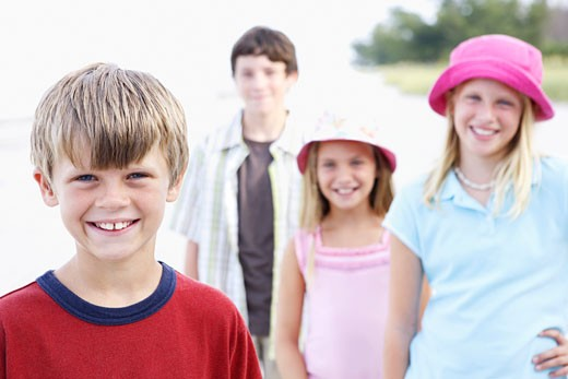 Children posing on beach : Stock Photo