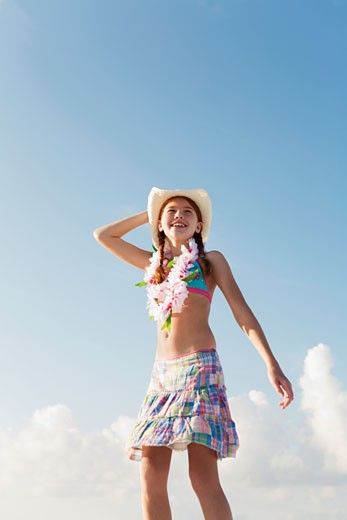 Girl in bathing suit with lei around neck : Stock Photo