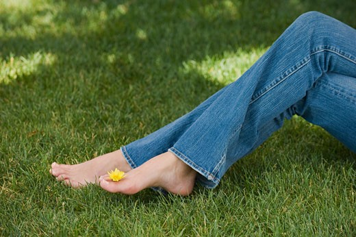 Stock Photo: 1795R-17575 Woman balancing flower on toes
