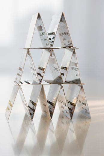 Card-house formed with credit cards : Stock Photo
