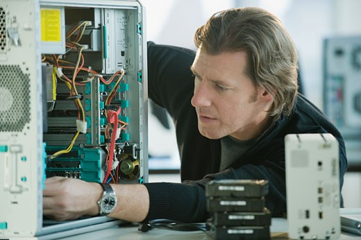 Technician repairing computer : Stock Photo