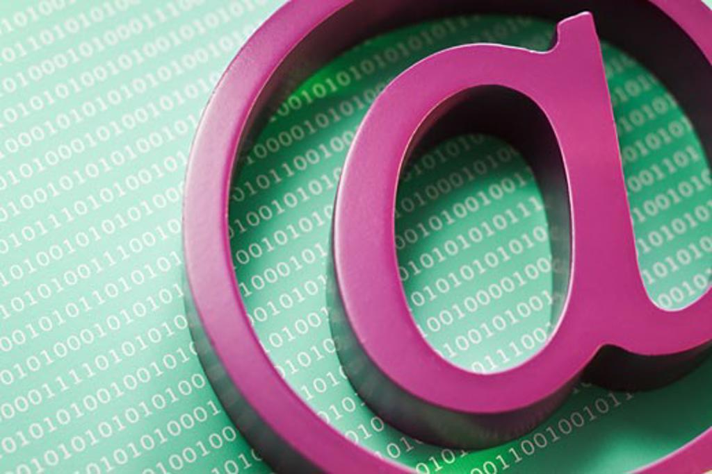 """Close up of """"at' symbol and binary code : Stock Photo"""