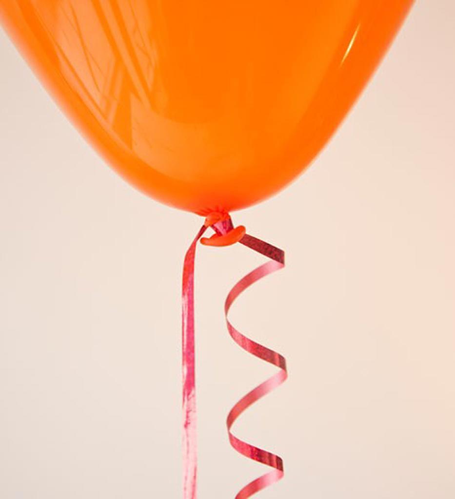 Stock Photo: 1795R-19360 Orange balloon and ribbon