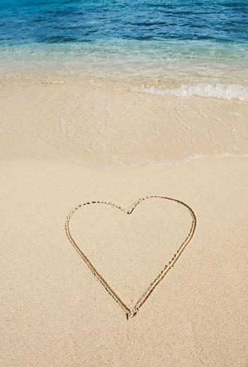 Heart drawn in sand : Stock Photo