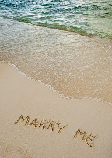 Stock Photo: 1795R-19762 Marry me message written in sand