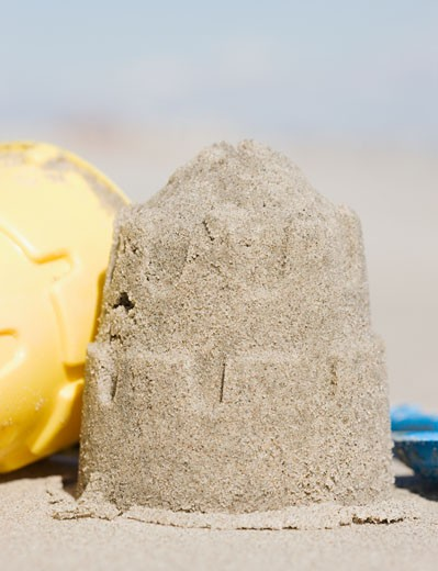 Sand castle mold on beach : Stock Photo