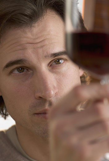 Closeup of man looking at wine : Stock Photo