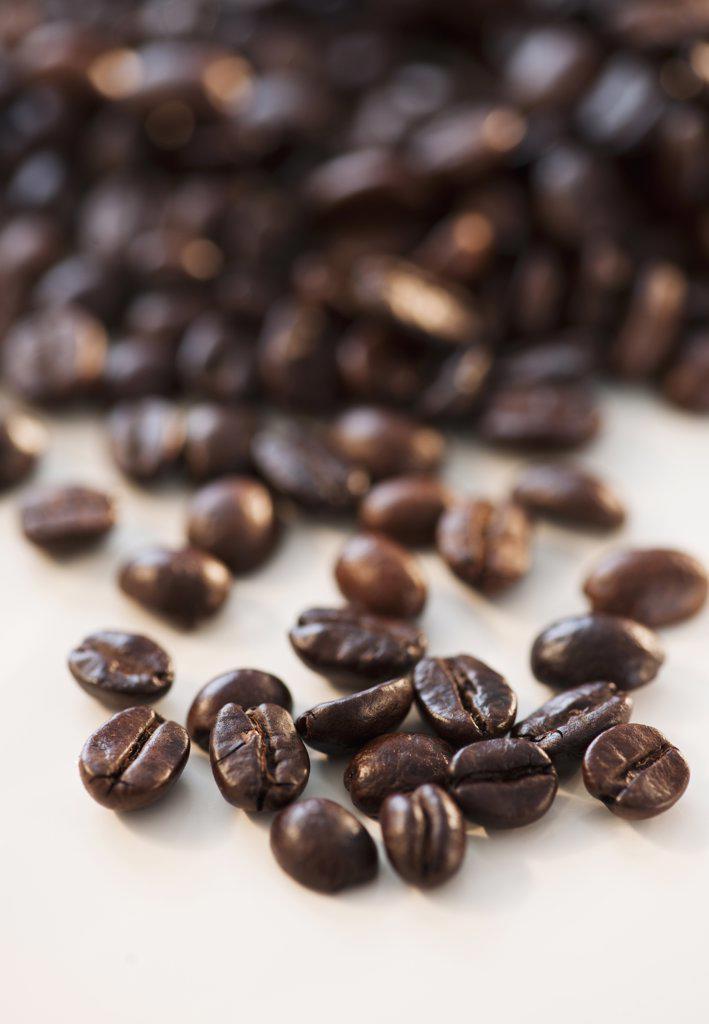 Roast coffee beans, studio shot : Stock Photo