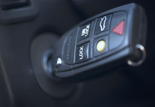 Closeup of key in car ignition : Stock Photo