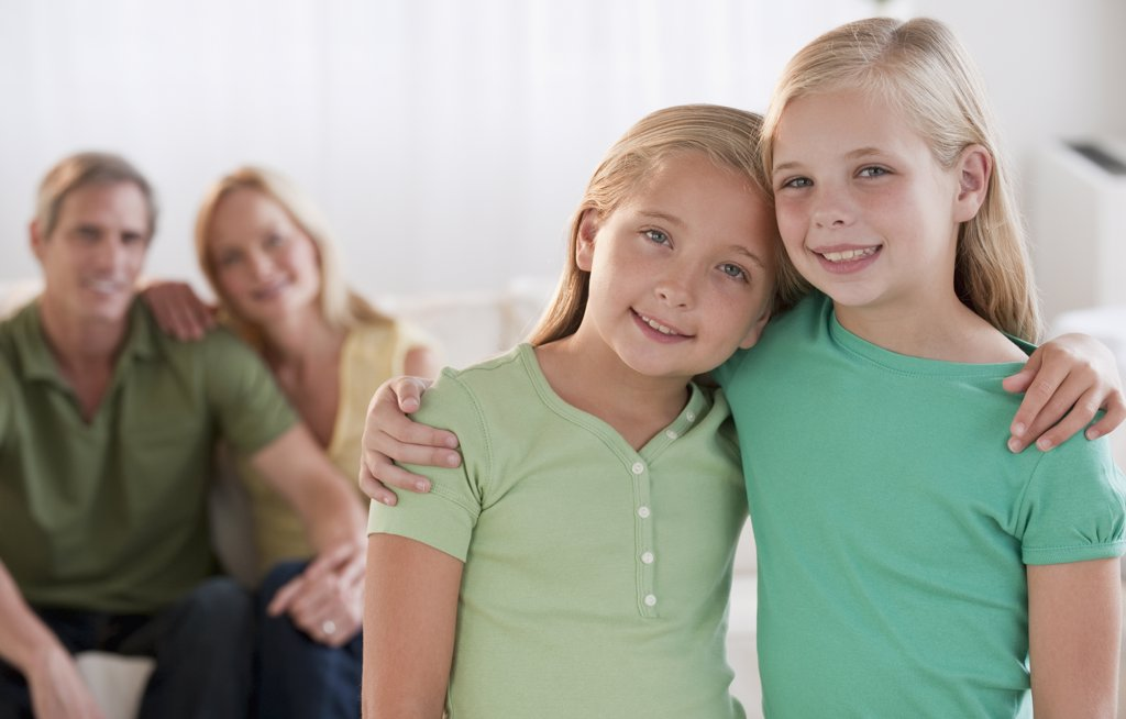 Happy sisters at home : Stock Photo