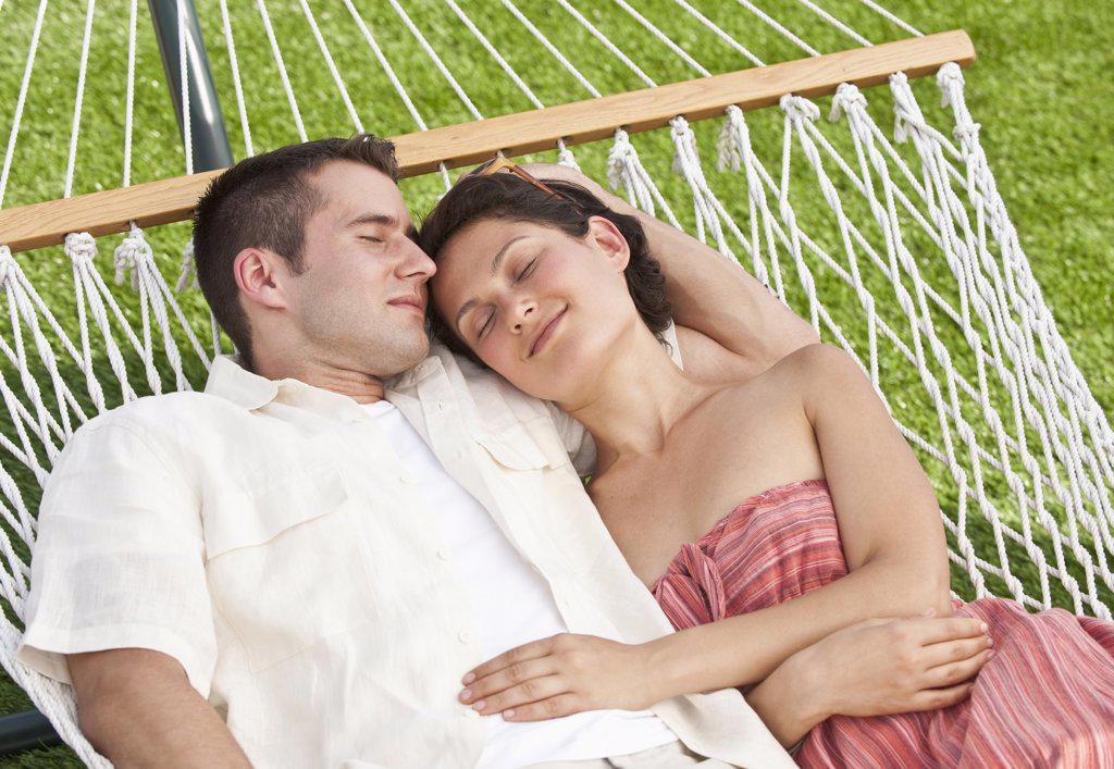 Stock Photo: 1795R-24030 Couple on hammock