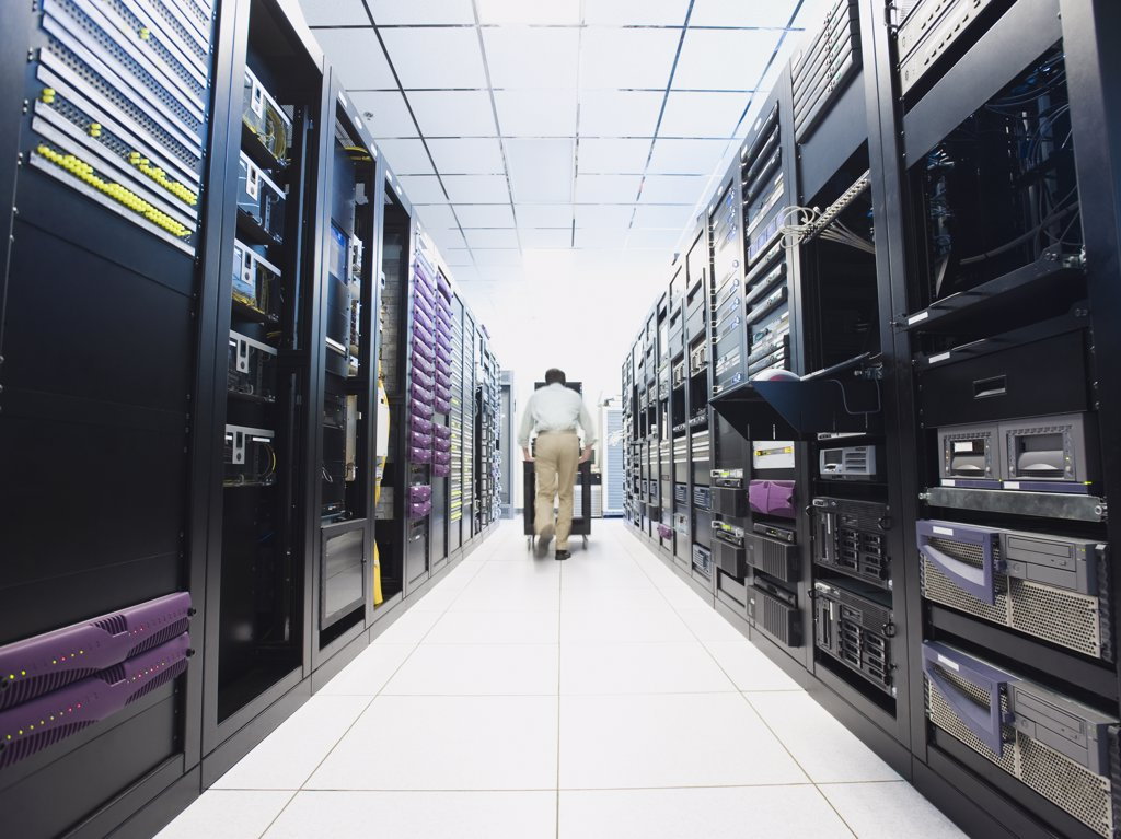 Man working in data center : Stock Photo