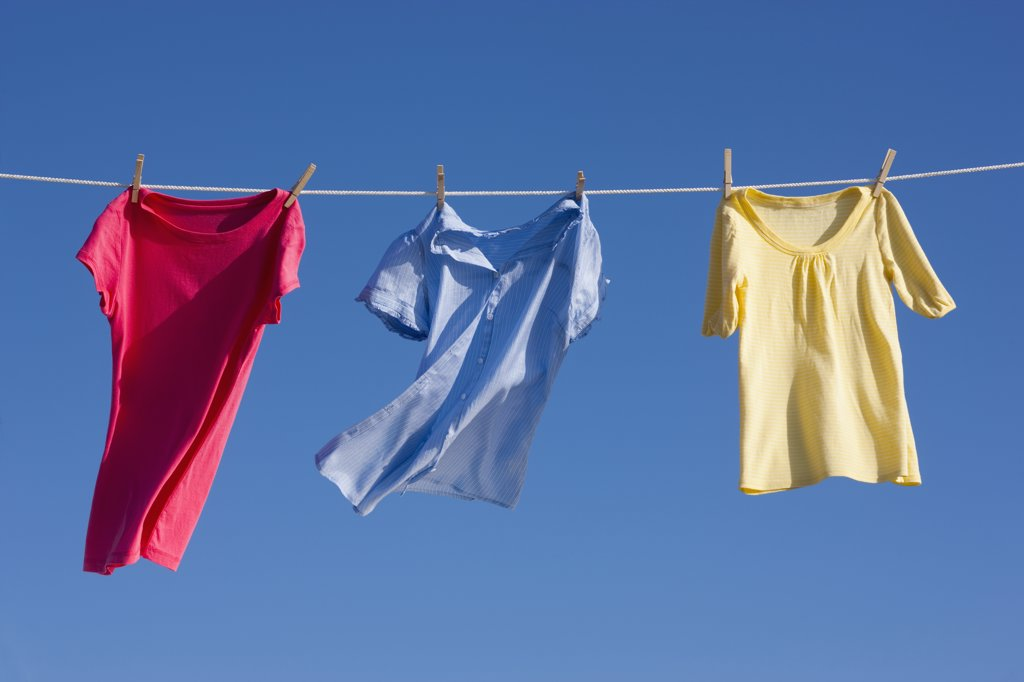 Shirts on clothes line : Stock Photo