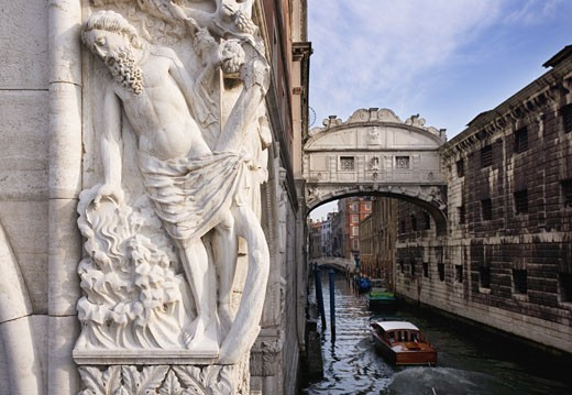 The Bridge of Sighs with sculpture depicting Drunkenness of Noah Doge's Palace Venice, Italy : Stock Photo