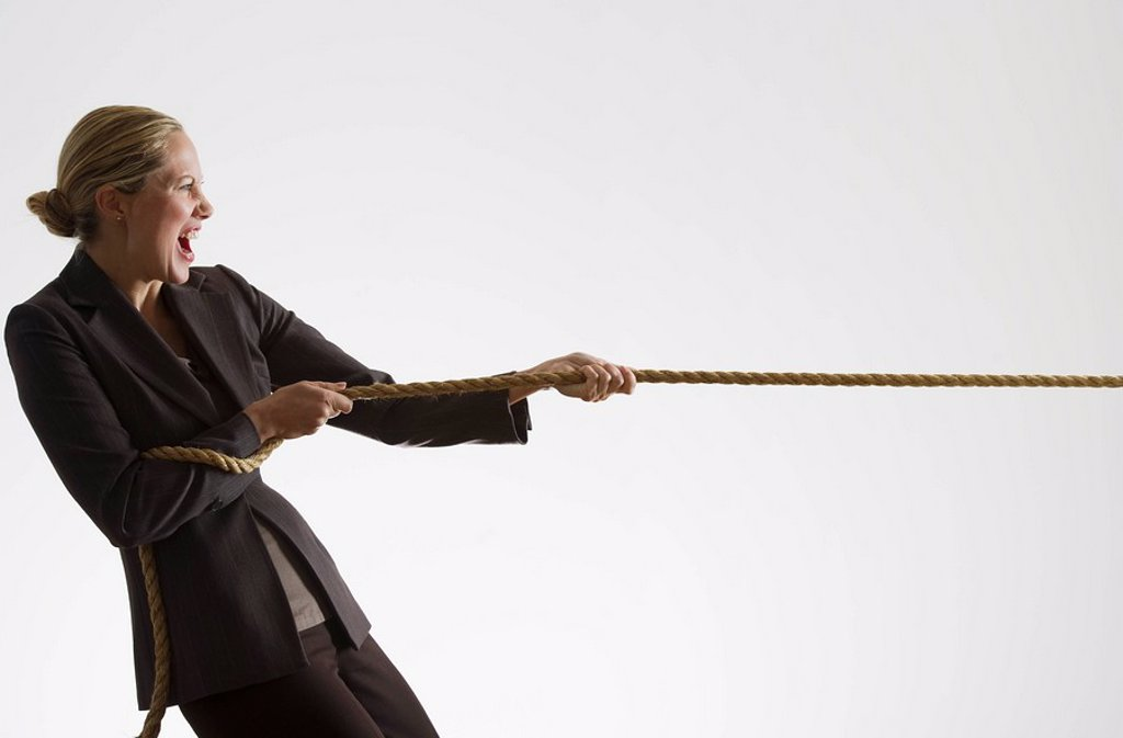 Woman pulling a rope : Stock Photo