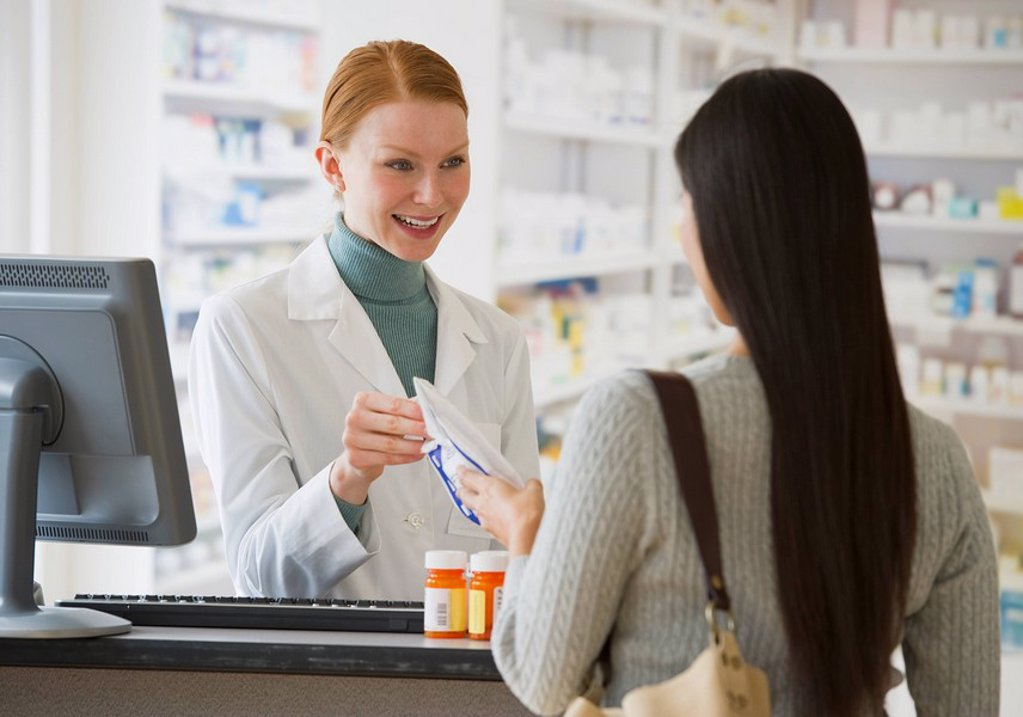 Stock Photo: 1795R-25212 Pharmacist giving prescription to customer