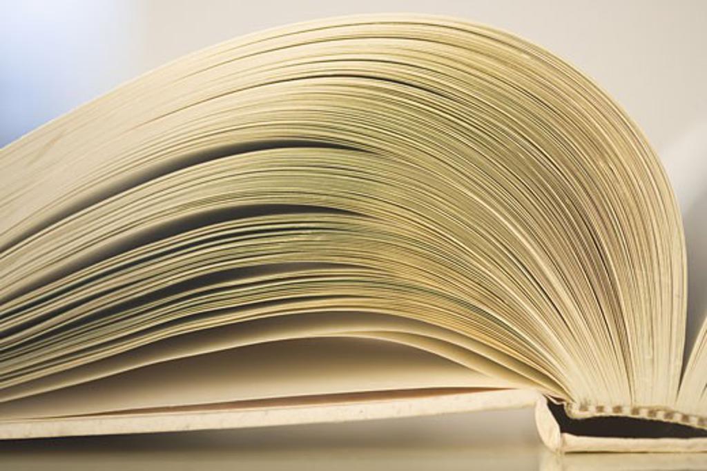 Closeup of an open book : Stock Photo