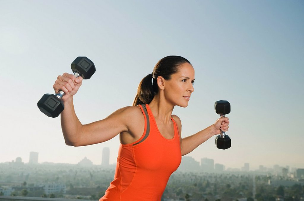 Stock Photo: 1795R-25883 Woman doing weight training