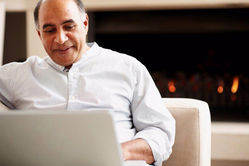 Stock Photo: 1795R-26263 Man working on laptop