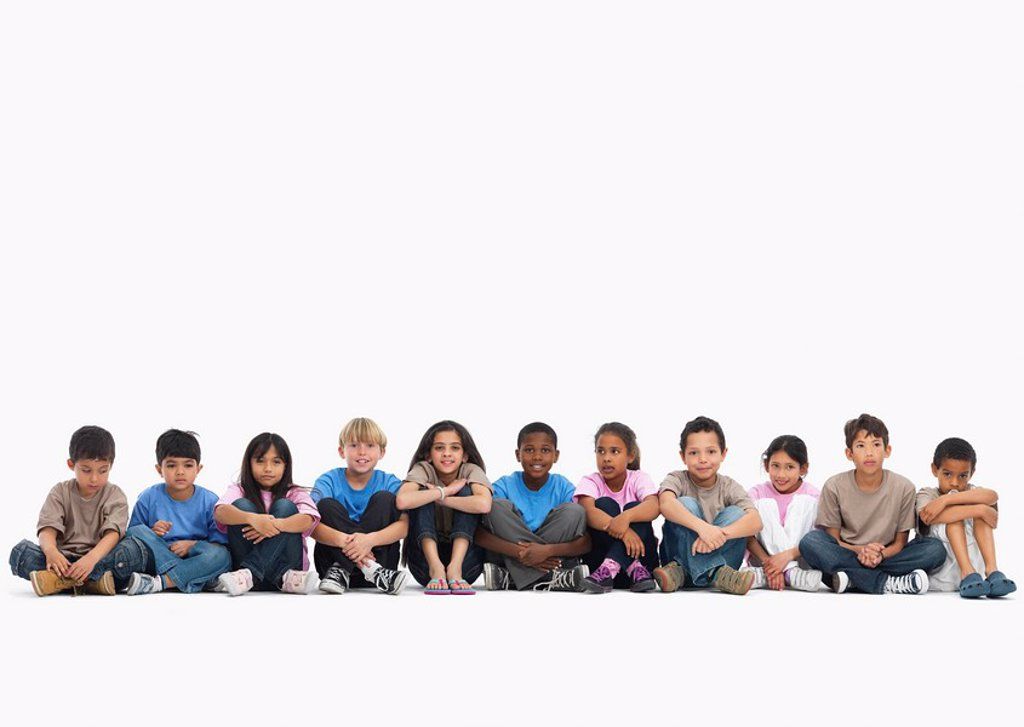 Children sitting in a row : Stock Photo