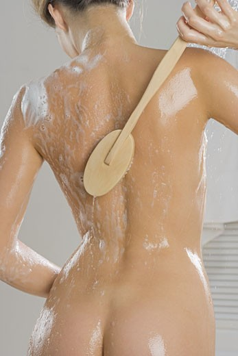 Rear view of woman bathing : Stock Photo
