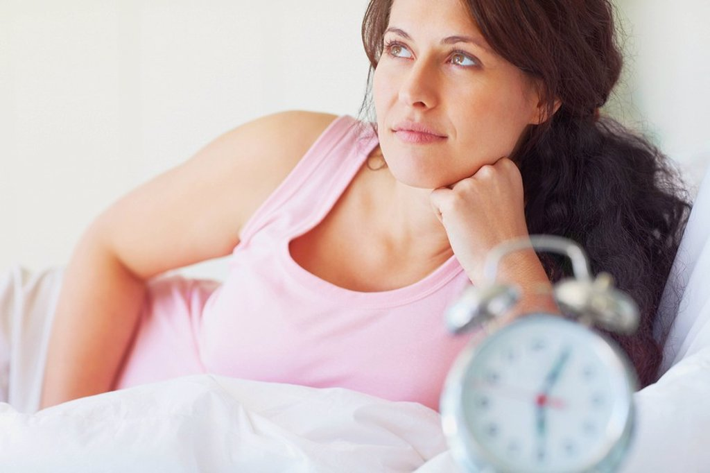 Woman thinking in the bedroom : Stock Photo