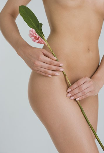 Nude female holding flower : Stock Photo