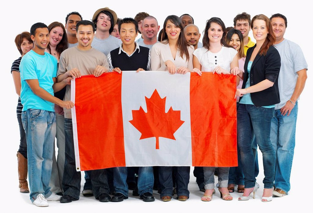Group of people holding Canadian flag : Stock Photo