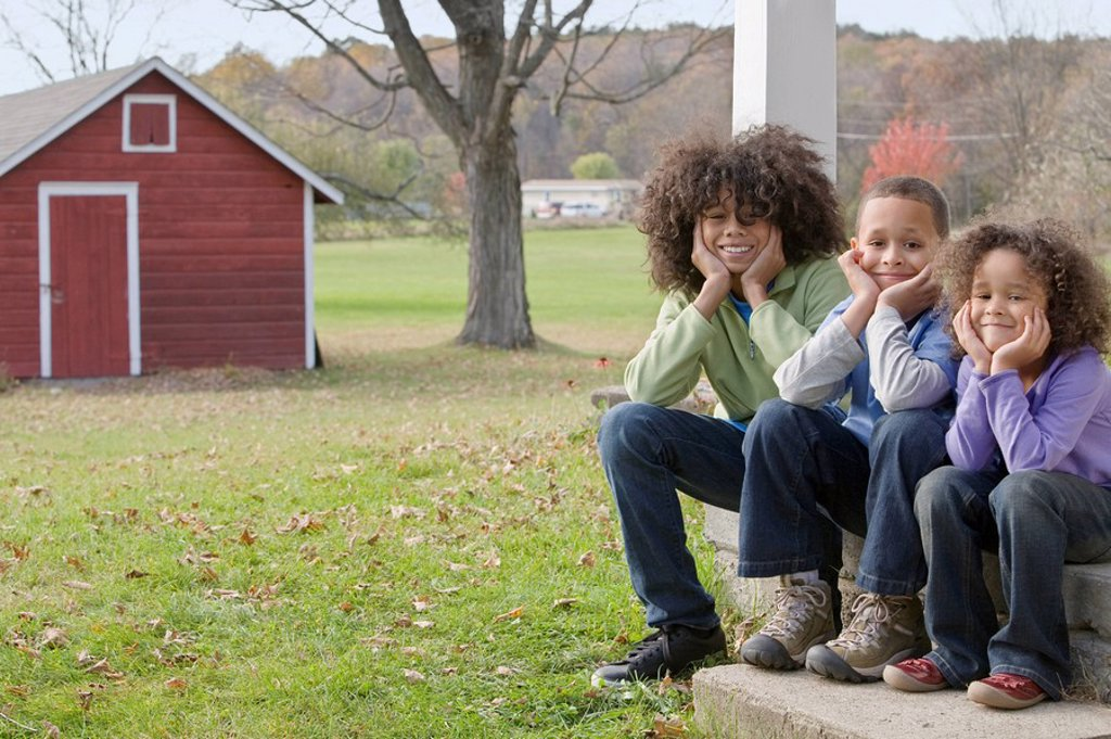 Family sitting on porch : Stock Photo