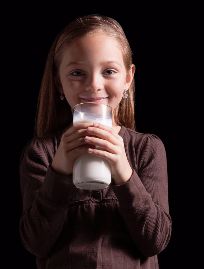 Young girl drinking glass of milk : Stock Photo