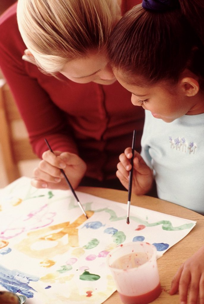 Student painting with teacher : Stock Photo