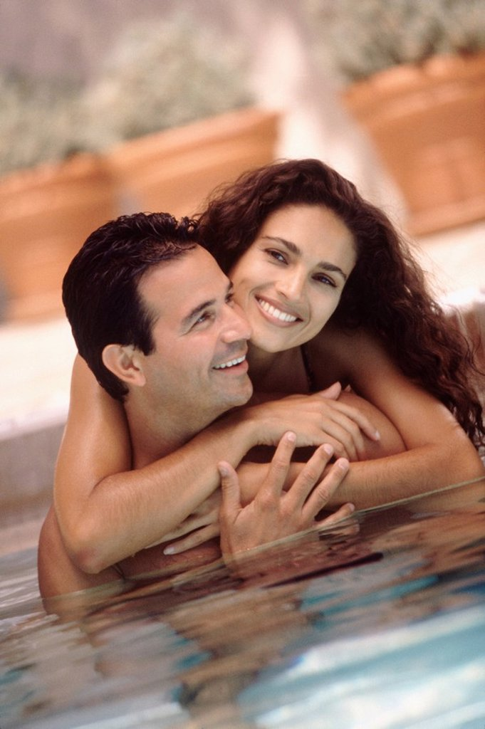 Stock Photo: 1795R-28273 Couple in a pool