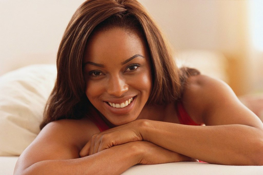 Stock Photo: 1795R-28315 Beautiful woman relaxing on her bed