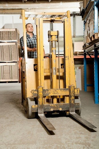 Fork lift and driver : Stock Photo