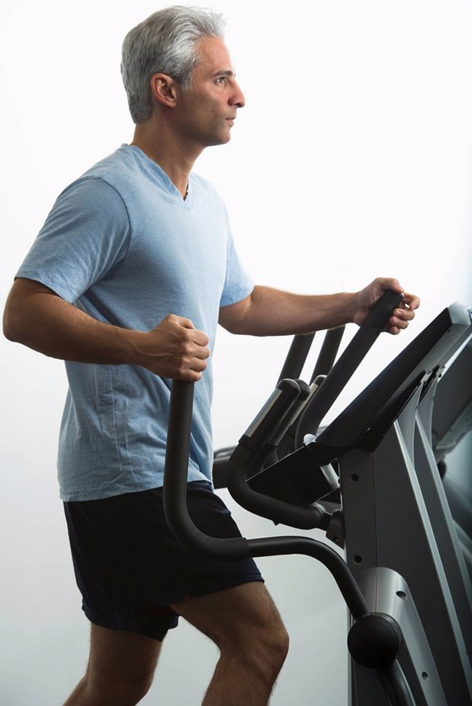 Man exercising on Stairmaster : Stock Photo