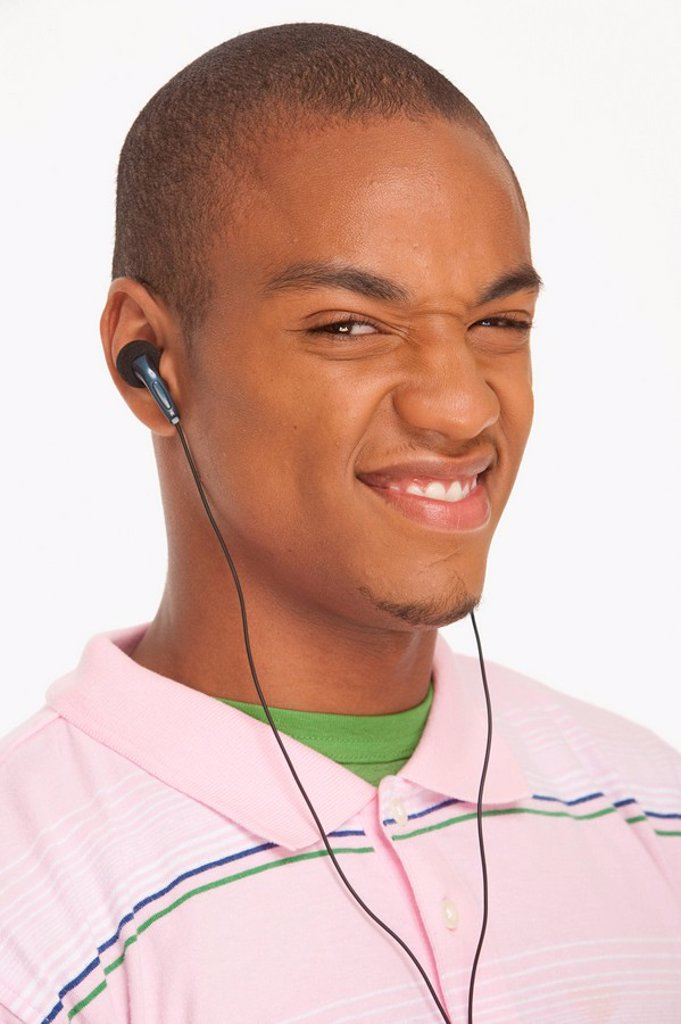 Stock Photo: 1795R-29244 Man wearing earphones making a funny face