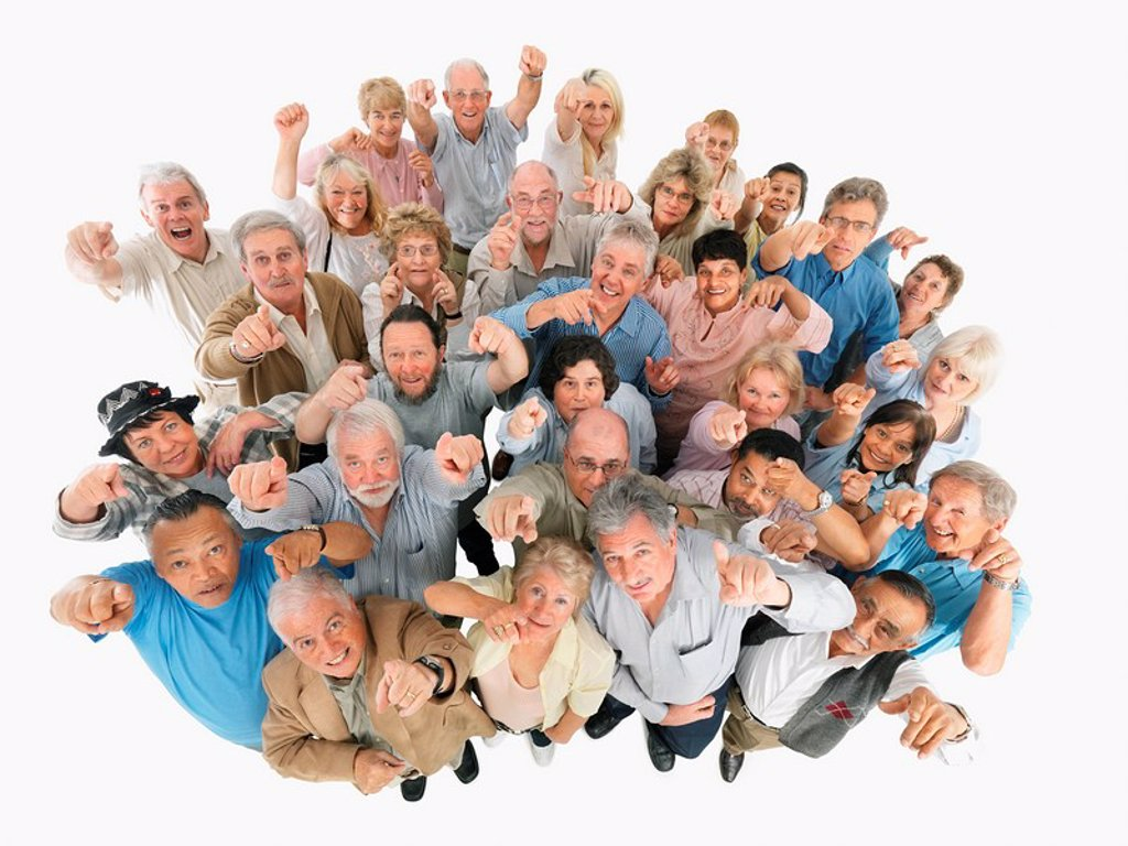 A group of people pointing up : Stock Photo