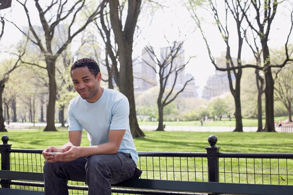 Man sitting on bench in Central Park : Stock Photo