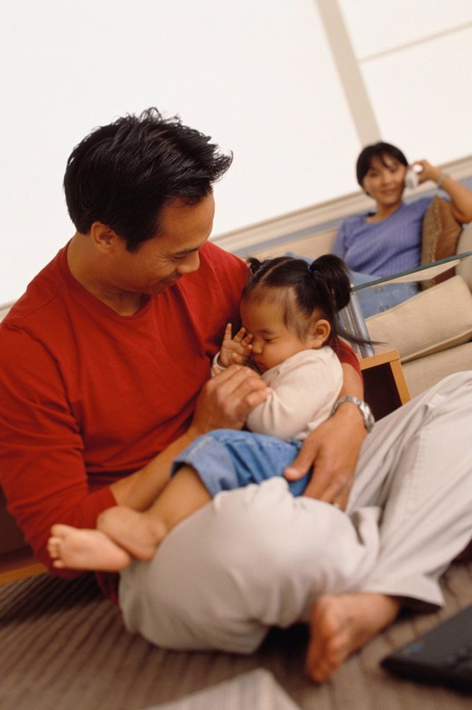 Father holding his infant daughter : Stock Photo