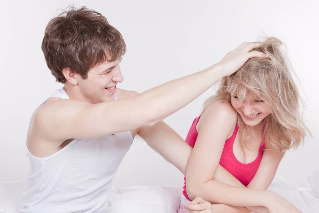 Stock Photo: 1795R-29453 Playful couple in bed