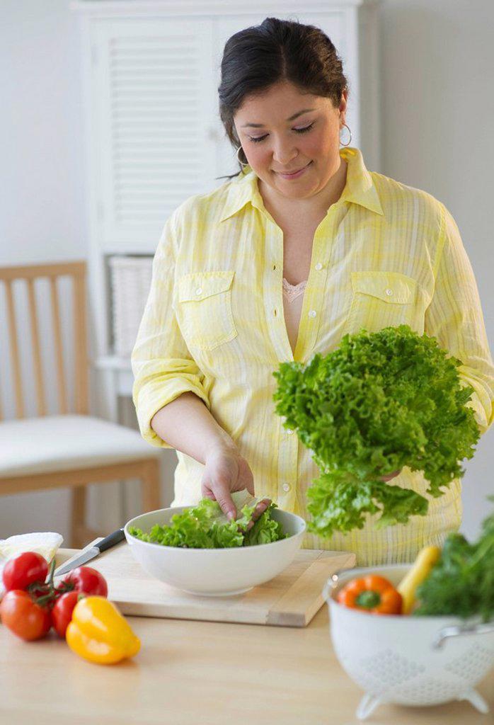 Woman preparing a salad : Stock Photo