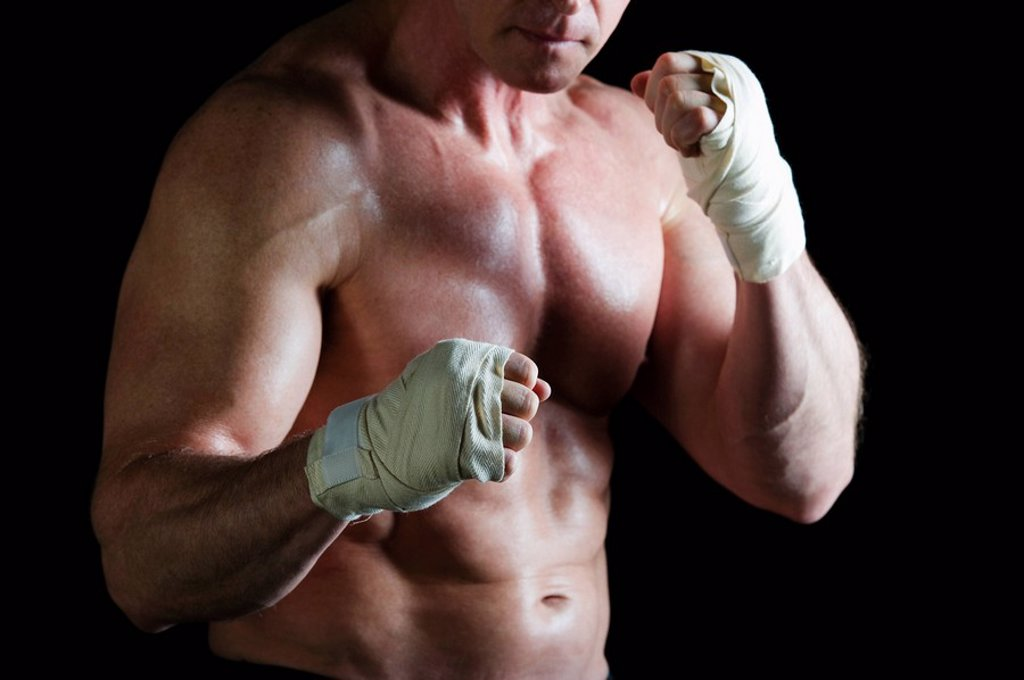 Stock Photo: 1795R-29855 Boxer with taped hands