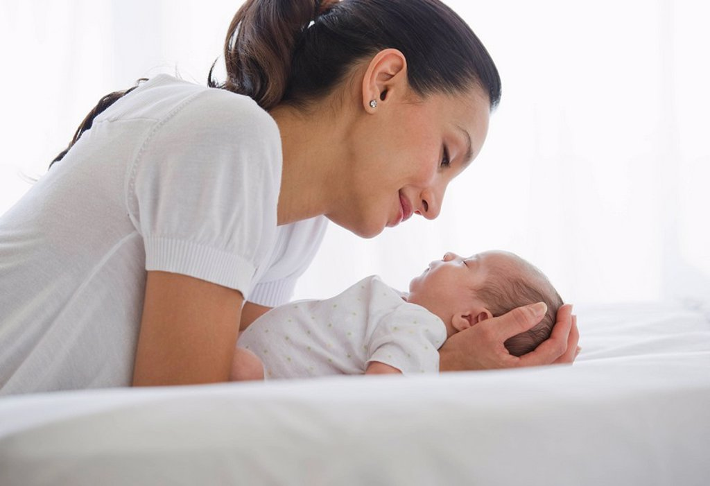 Mother sharing a tender moment with her baby : Stock Photo